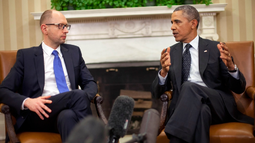 President Barack Obama, right, talks with Ukraine Prime Minister Arseniy Yatsenyuk, left, in the Oval Office of the White House in Washington, Wednesday, March 12, 2014. Obama welcomed Ukraine's new prime minister as the U.S. seeks to highlight ties with the former Soviet republic now caught in a diplomatic battle between East and West. (AP Photo/Pablo Martinez Monsivais)