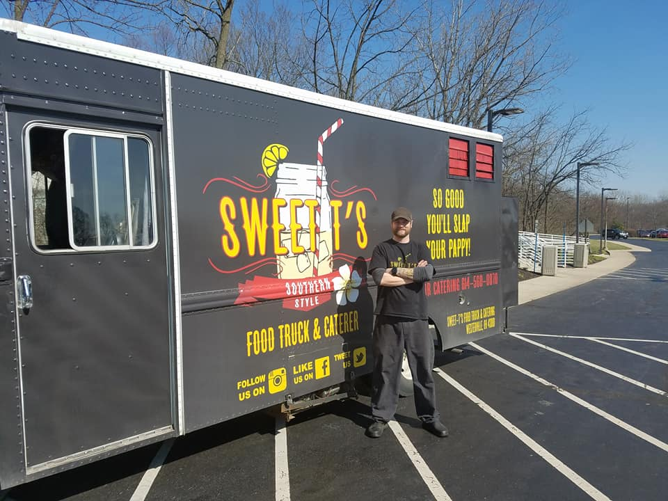 Owner Travis Hyde posing with his food truck. (Courtesy: Travis Hyde)<p></p>