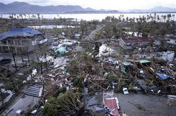 Tacloban Airport is covered by debris after powerful Typhoon Haiyan hit Tacloban city, in Leyte province in central Philippines, Saturday, Nov. 9, 2013.