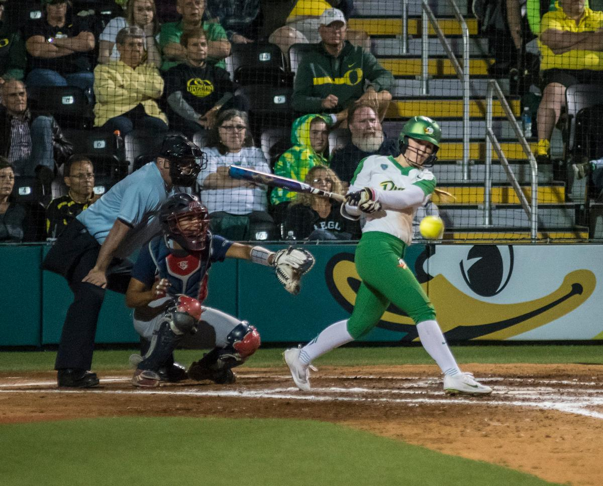 Oregon Ducks Jenna Lilley (#00) hits the ball. The No. 3 Oregon Ducks defeated the University of Illinois Chicago Flames 13-0 with the run-rule on Saturday night at Jane Sanders Stadium. The Ducks scored in every inning and then scored nine runs at the bottom of the fourth. The Oregon Ducks are now 22-0 in NCAA regional games. The Oregon Ducks play Wisconsin next on Saturday, May 20 at 2pm at Jane Sanders Stadium. Photo by Cheyenne Thorpe, Oregon News Lab