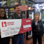 Two local businesses awarded checks for selling winning lottery tickets