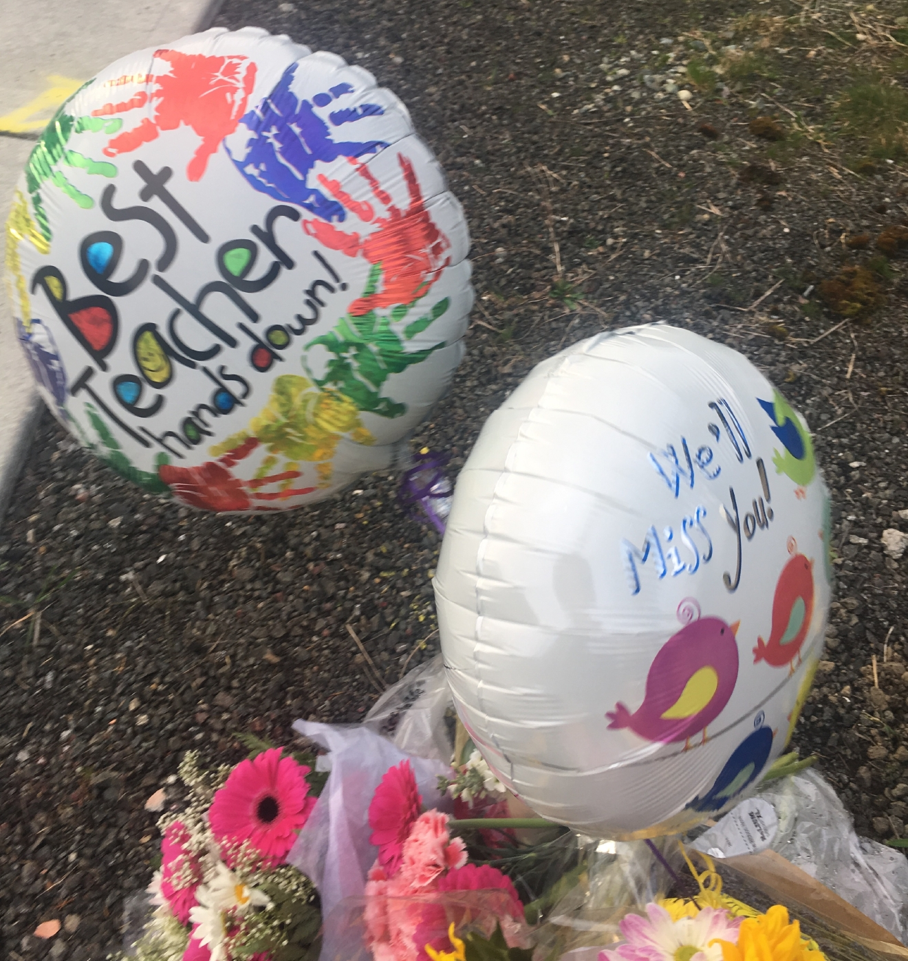A growing number of flower bouquets, balloons, and heartbreaking messages have been placed near the intersection to honor Amy Higgins. (KOMO Photo)