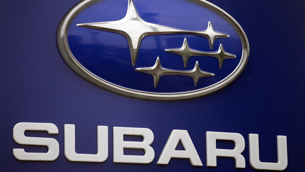 In this Aug. 31, 2011, file photo, a Subaru logo is displayed on a sign at a dealer's lot, in Portland, Ore. Subaru is recalling more than 660,000 cars and SUVs because the brake lines can rust and leak fluid, and that can cause longer stopping distances. For about half the vehicles, it's the second recall for the same problem. (AP Photo/Rick Bowmer, File)