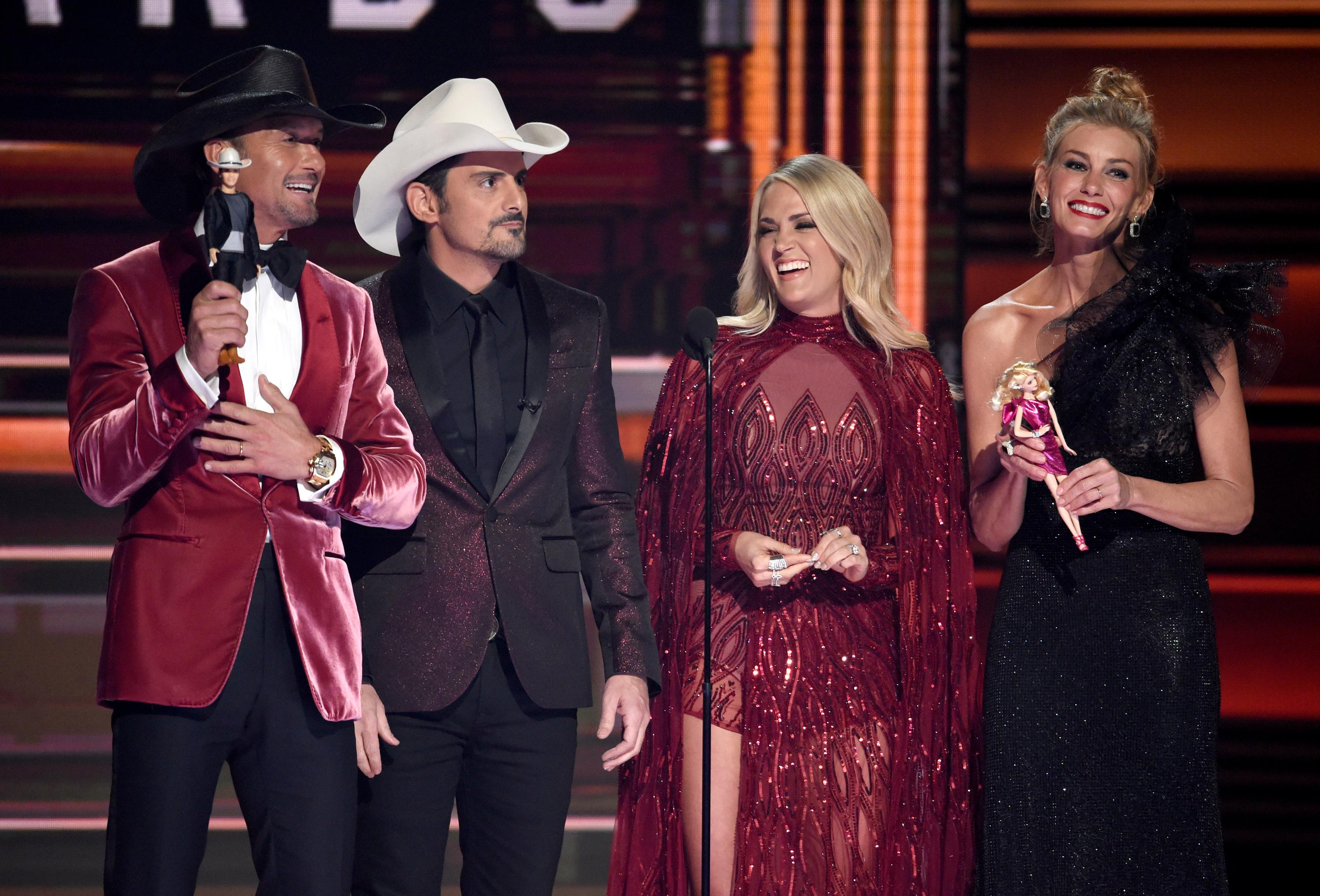 Tim McGraw, from left, Brad Paisley, Carrie Underwood and Faith Hill speak at the 51st annual CMA Awards at the Bridgestone Arena on Wednesday, Nov. 8, 2017, in Nashville, Tenn. (Photo by Chris Pizzello/Invision/AP)