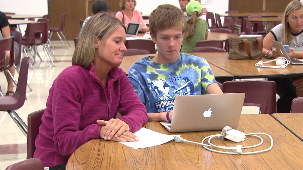 Parents and students logged into new Macbook Airs at Lineville Intermediate in Suamico on Monday, August 18, 2014.