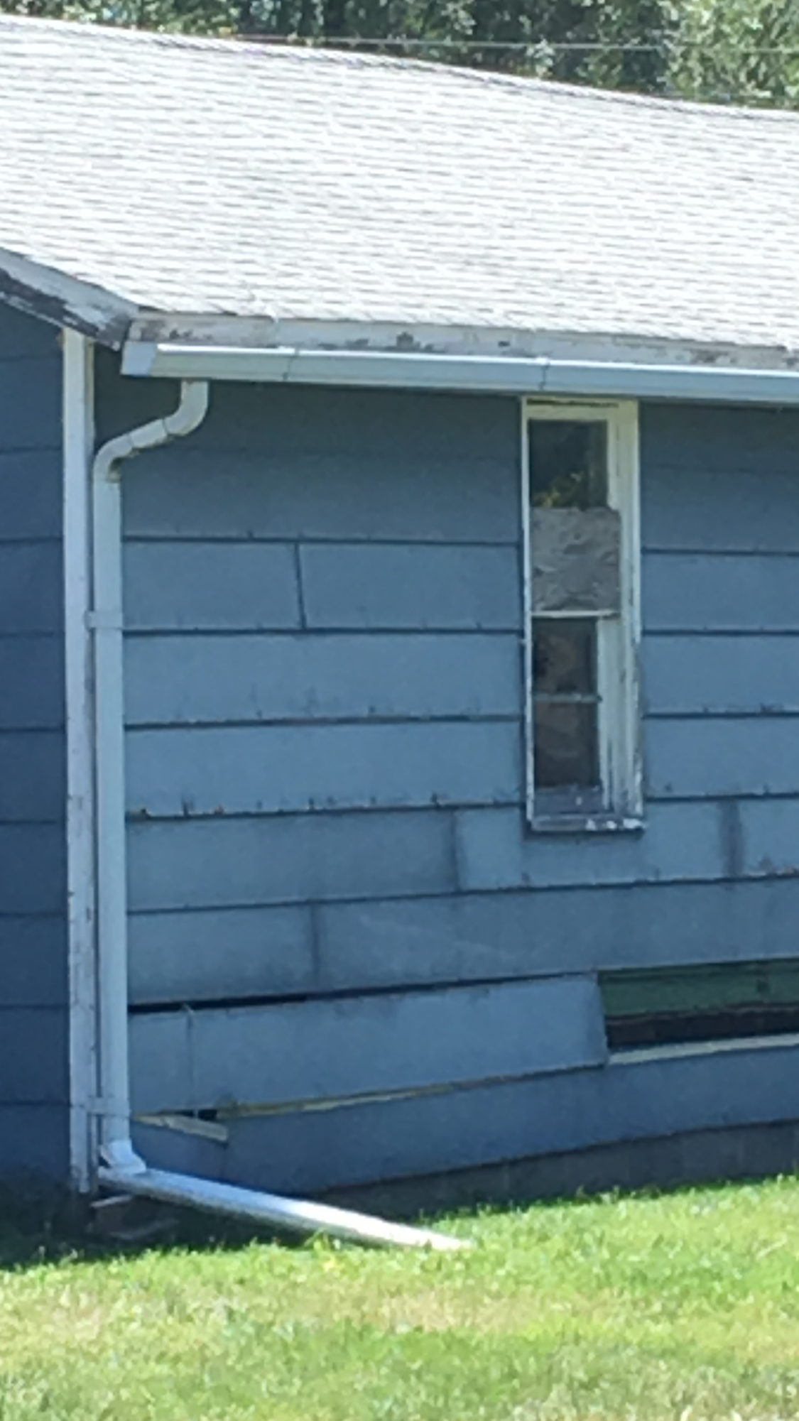 Kirksville police are trying to determine if the shot fired through this window of a local conservation agent's home was an accident or intentional. (John Garlock/KTVO)