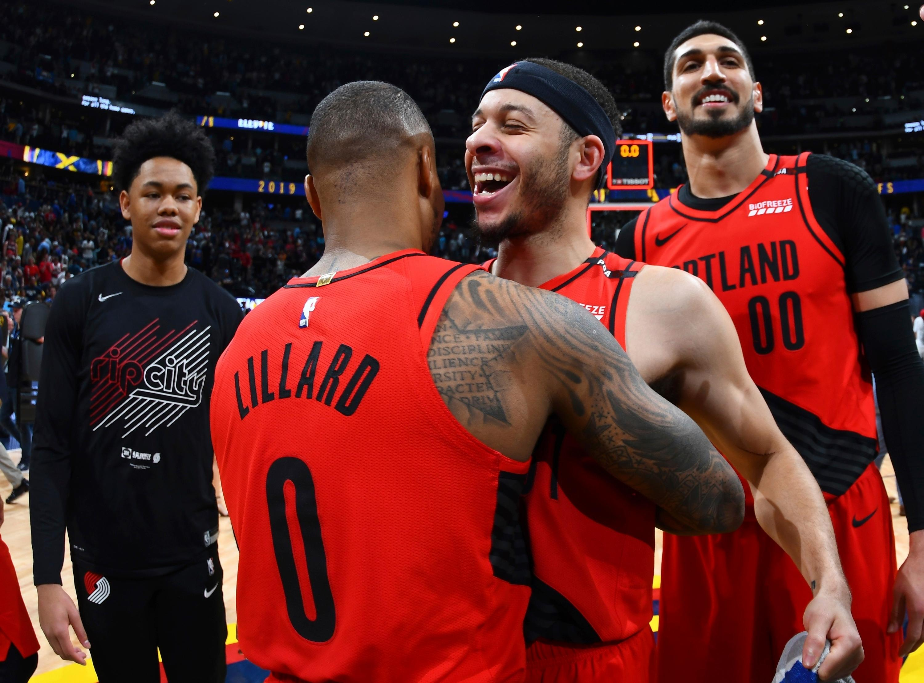 CORRECTS BYLINE IN SIGNOFF TO JOHN LEYBA NOT DAVID ZALUBOWSKI From front, Portland Trail Blazers guard Damian Lillard celebrates with guard Seth Curry and center Enes Kanter after the second half of Game 7 of an NBA basketball second-round playoff series Sunday, May 12, 2019, in Denver. The Trail Blazers won 100-96. (AP Photo/John Leyba)