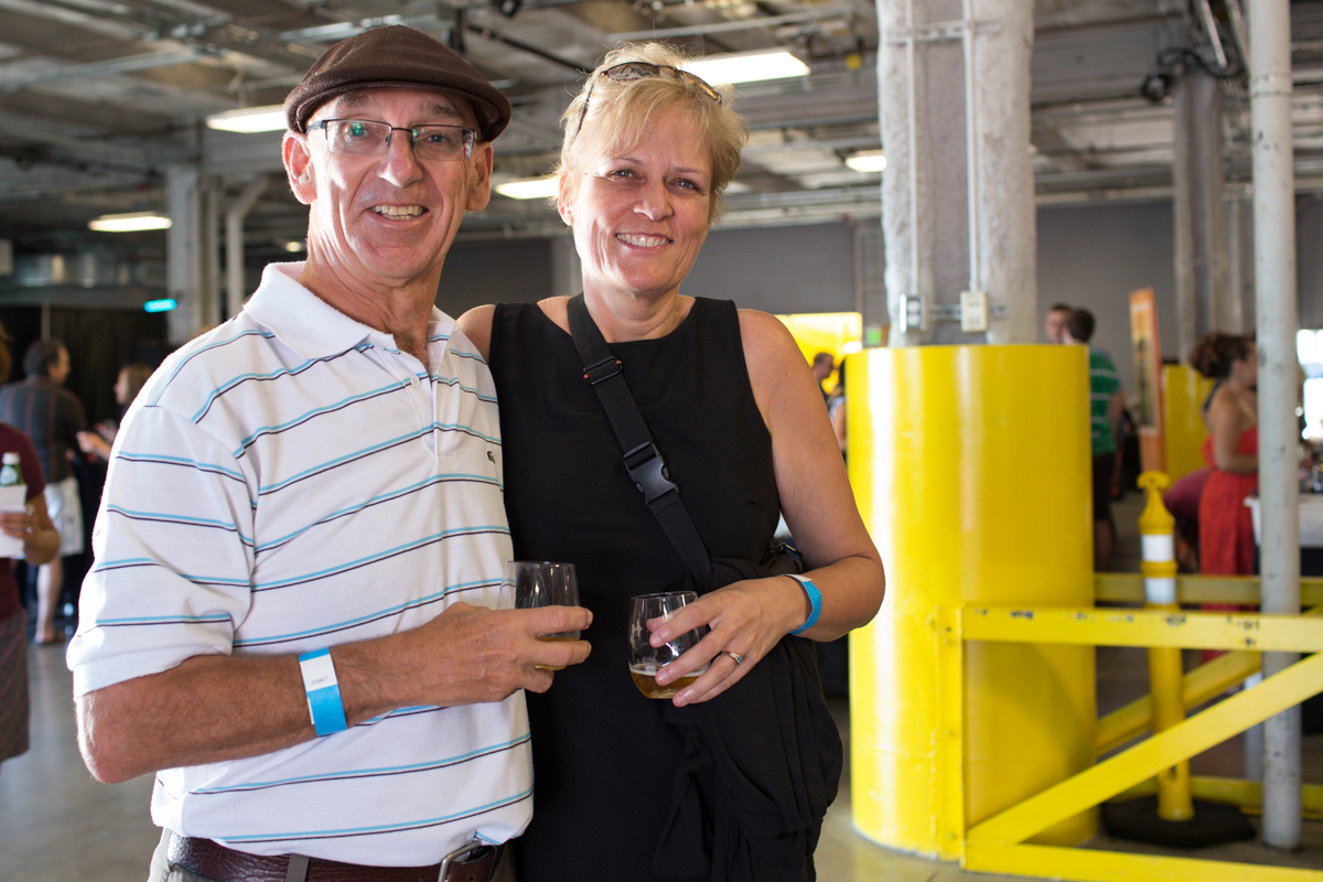 "Margaret and Gary celebrated at Wine Rocks last night at Pier 66 in Seattle. Wine Rocks is an annual not-for-profit gathering of local winemakers and craft brewers celebrating ""exceptional wine, unique distillates, outstanding beer, groovy tunes, savory fare and one heckuva backdrop."" (Image: Joshua Lewis / Seattle Refined)"