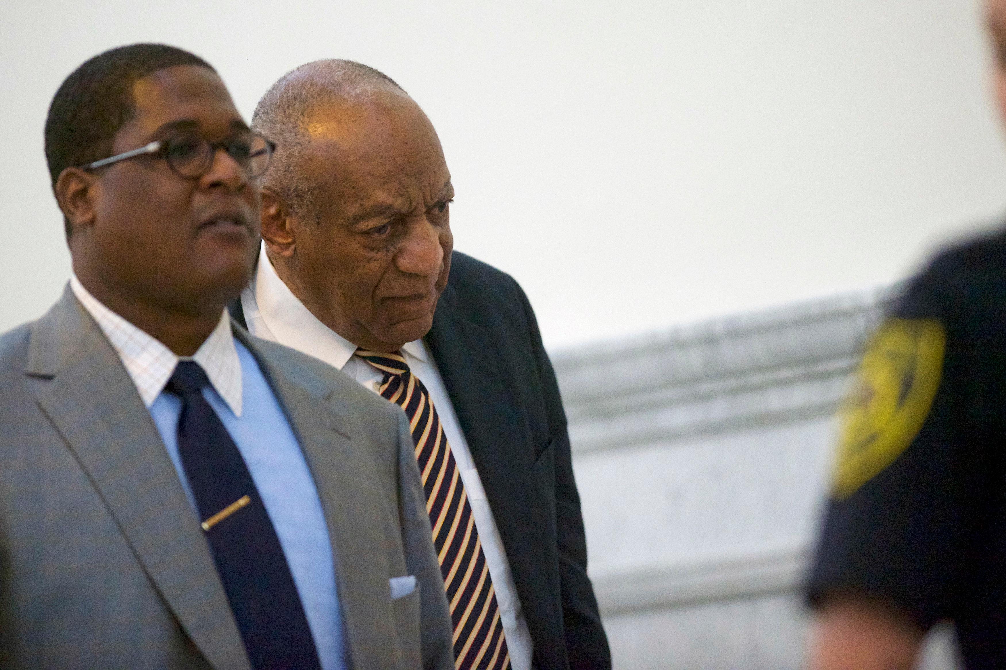 Bill Cosby exits the courtroom during his sexual assault trial at the Montgomery County Courthouse in Norristown, Pa., Wednesday, June 14, 2017.  (Mark Makela/Pool Photo via AP)