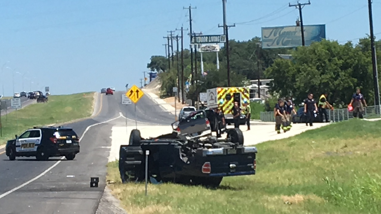 Driver crashes truck into barrier at Loop 1604 and Braun Road, lands on top of another pickup (SBG San Antonio)