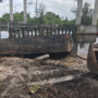 Barge won't budge: crews struggle to clear 11-year old wreck