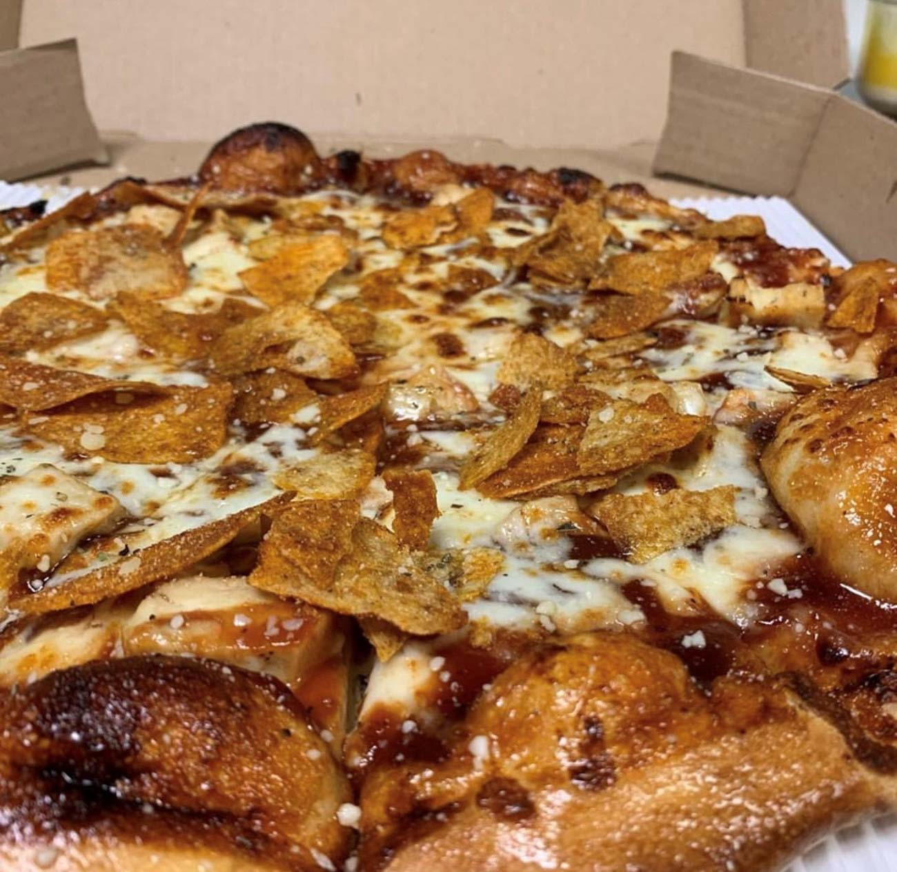 The Grippo's: a BBQ sauce base, chicken, mozzarella cheese, & topped with BAR-B-Q flavored Grippo's / Image courtesy of Poseidon's Pizza Company // Published: 7.8.20