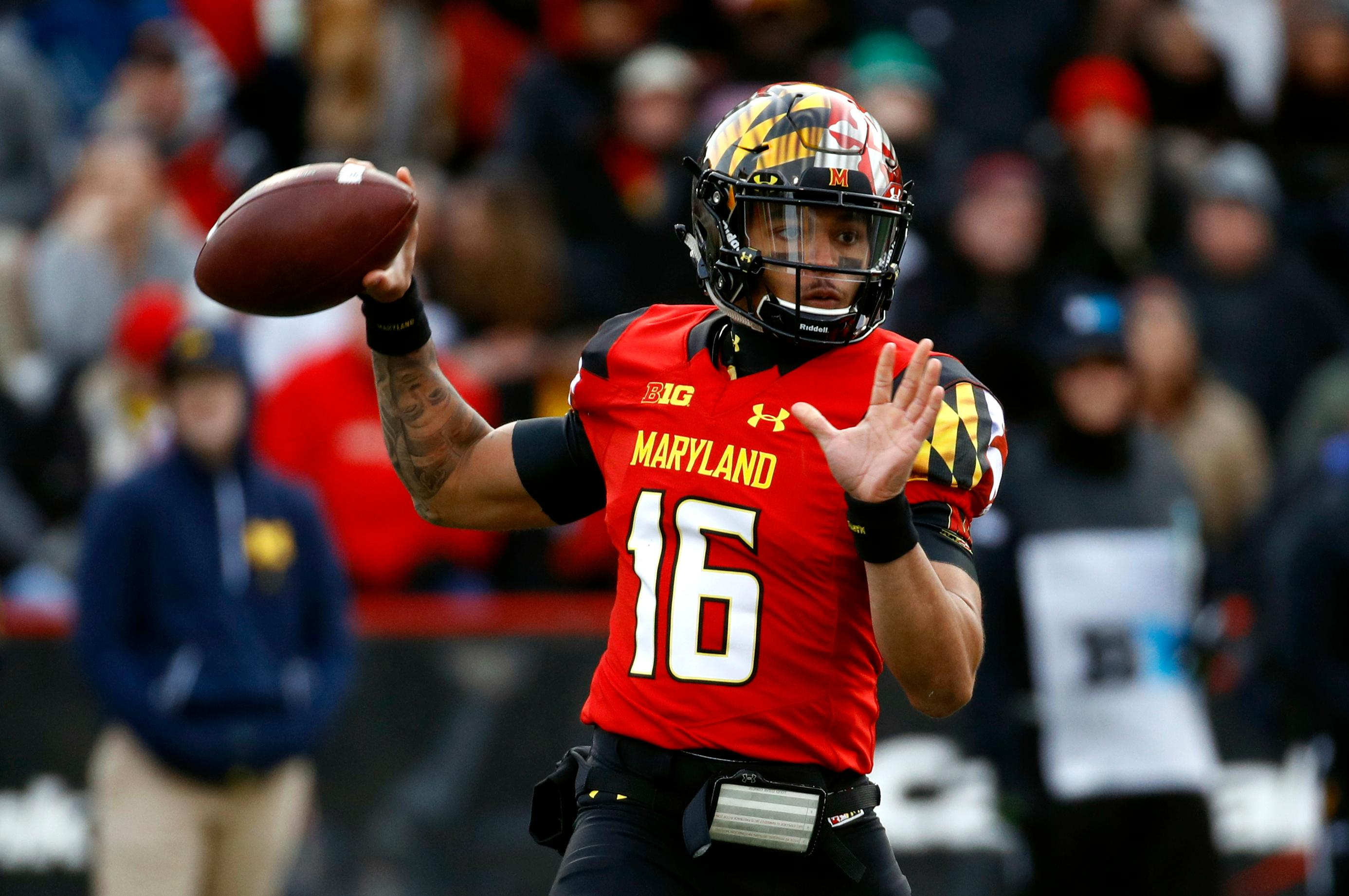 Maryland quarterback Ryan Brand throws to a receiver in the first half of an NCAA college football game against Michigan in College Park, Md., Saturday, Nov. 11, 2017. (AP Photo/Patrick Semansky)
