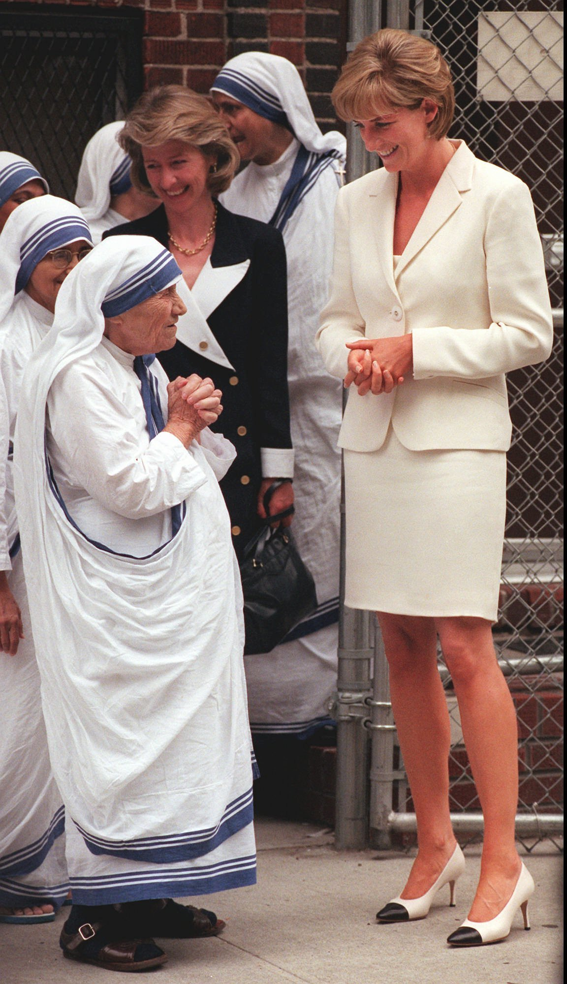 "FILE - In this Wednesday, June 18, 1997 file photo, Mother Teresa, left, says goodbye to Britain's Princess Diana after receiving a visit from her in New York. Princess Diana met privately for 40 minutes with Mother Teresa at The Missionaries of Charity in the South Bronx section of New York. It has been 20 years since the death of Princess Diana in a car crash in Paris and the outpouring of grief that followed the death of the ""people's princess.""  (AP Photo/Bebeto Matthews, File)"