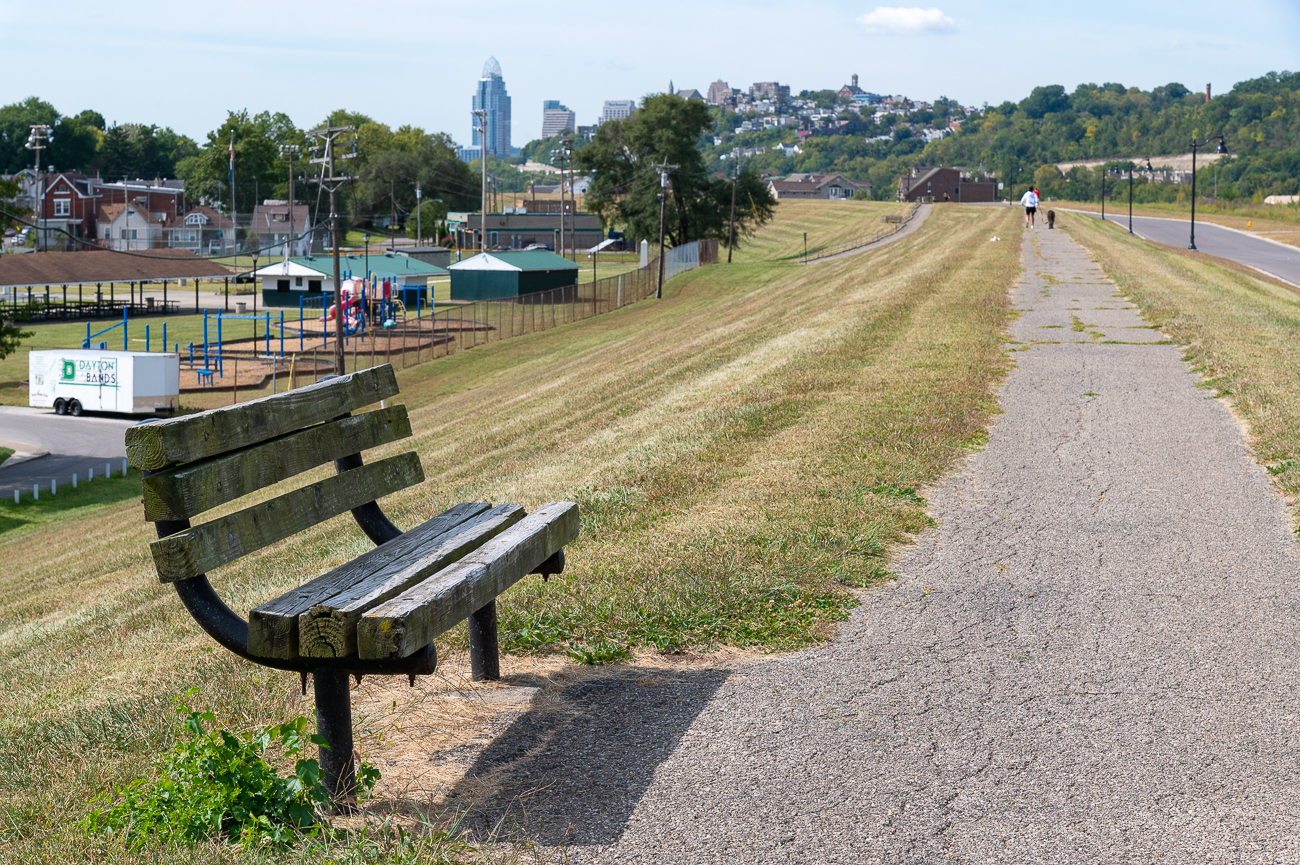The three-foot walking path at the peak of the flood wall is lined with park benches.{ }/ Image: Phil Armstrong // Published: 9.27.20