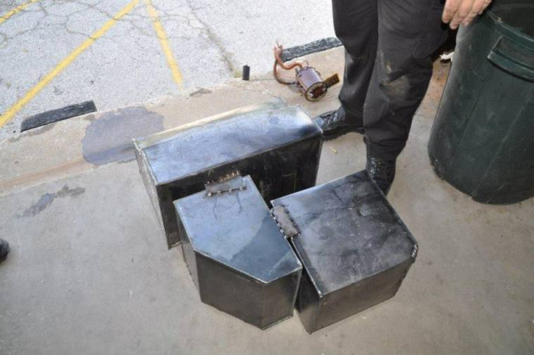 Three boxes were stacked inside the fuel tank. All were filled with compressed marijuana