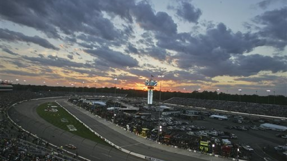 he sun sets behind the scoreboard during the NASCAR Sprint Cup auto race at Richmond International Raceway in Richmond, Va., Saturday, April 26, 2014. (AP Photo/Jason Hirschfeld)