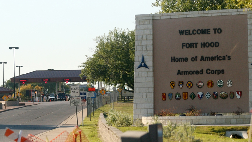 FILE - In this Thursday, Nov. 5, 2009, file photo, an entrance is shown to Fort Hood Army Base in Fort Hood, Texas. (AP Photo/Jack Plunkett)