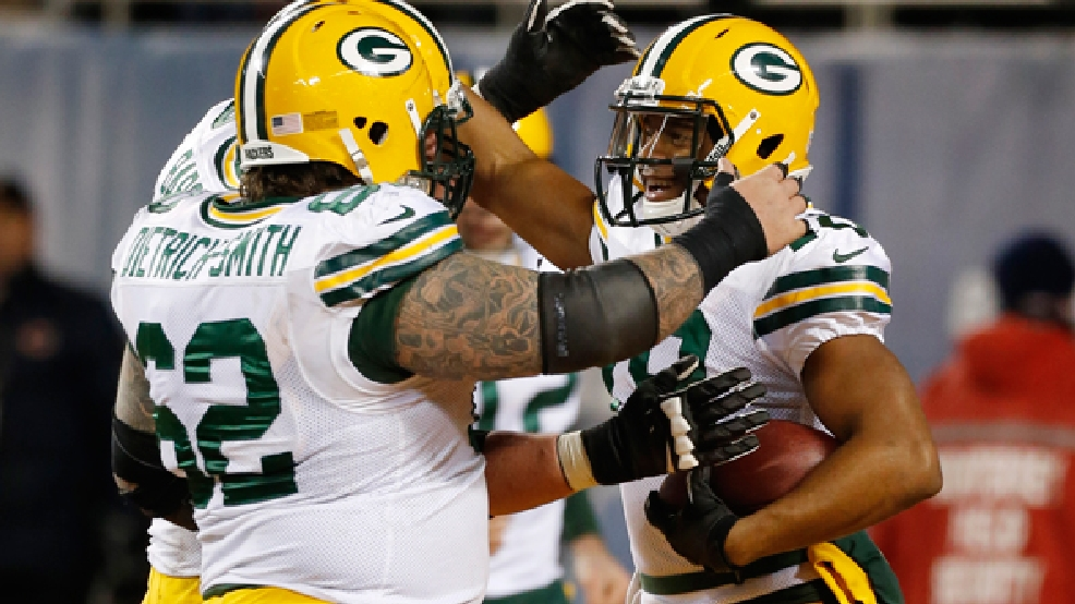 Green Bay Packers wide receiver Randall Cobb, right, celebrates a touchdown with his teammates during the second half of an NFL football game against the Chicago Bears, Sunday, Dec. 29, 2013, in Chicago. (AP Photo/Charles Rex Arbogast)