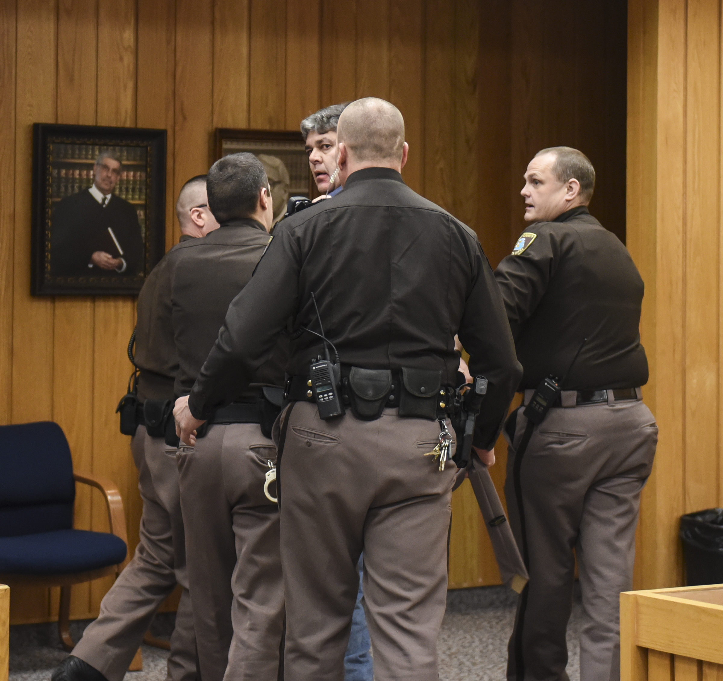 Randall Margraves, father of Lauren and Madison Margraves is detained after trying to attack Larry Nassar Friday, Feb. 2, 2018, in Eaton County Circuit Court during the second day of victim impact statements in Judge Janet Cunningham's courtroom in Charlotte, Mich.  The incident came during the third and final sentencing hearing for Nassar on sexual abuse charges. The charges in this case focus on his work with Twistars, an elite Michigan gymnastics club. (Matthew Dae Smith /Lansing State Journal via AP)