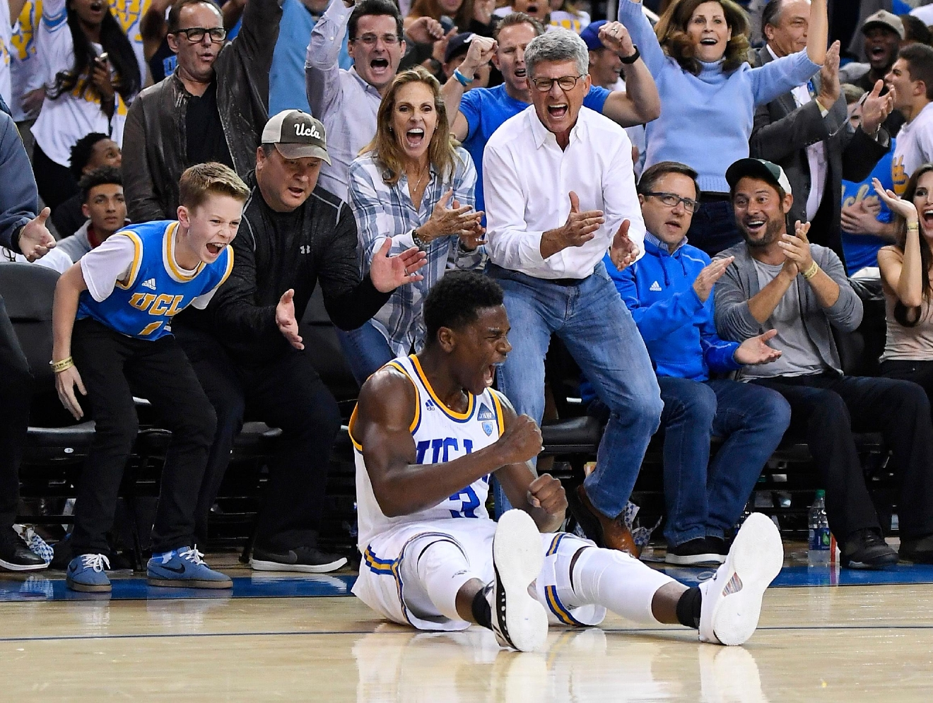 UCLA guard Aaron Holiday celebrates after scoring during the second half of the team's NCAA college basketball game against Oregon, Thursday, Feb. 9, 2017, in Los Angeles. UCLA won 82-p79. (AP Photo/Mark J. Terrill)