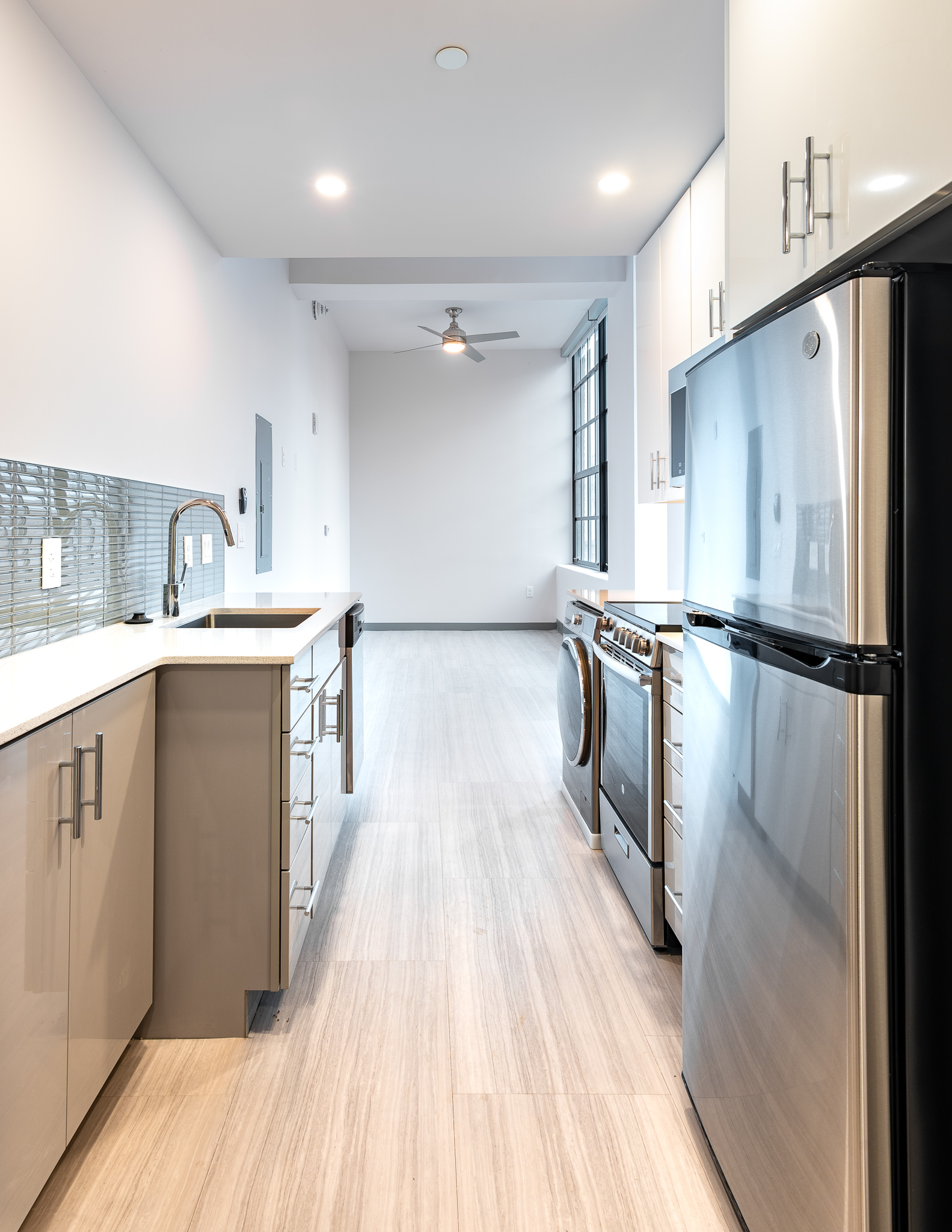Floor plan 6 is a micro apartment with a custom kitchen that features a combination washer/dryer unit. The shotgun-style layout provides uninterrupted sight lines throughout the whole apartment. / Image: Phil Armstrong, Cincinnati Refined // Published: 12.25.19