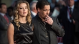 Report: Amber Heard, Johnny Depp settle domestic violence case
