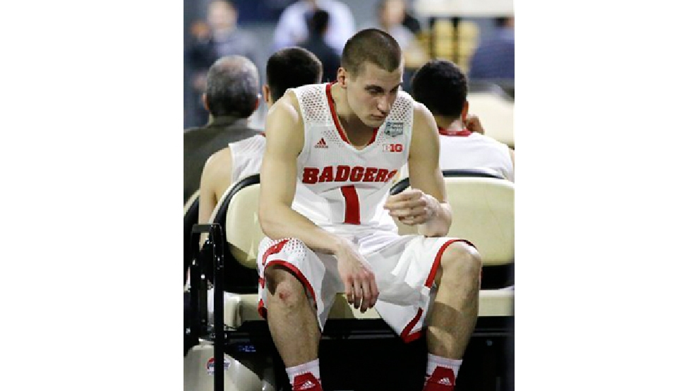 Wisconsin guard Ben Brust reacts after his team's 74-73 loss to Kentucky in an NCAA Final Four tournament college basketball semifinal game Saturday, April 5, 2014, in Arlington, Texas. (AP Photo/David J. Phillip)
