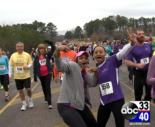 Two runners pose for an ABC 33/40 photographer during the 10th Annual Brenda Ladun Conquer Cancer Run, Saturday, March 1, 2014.