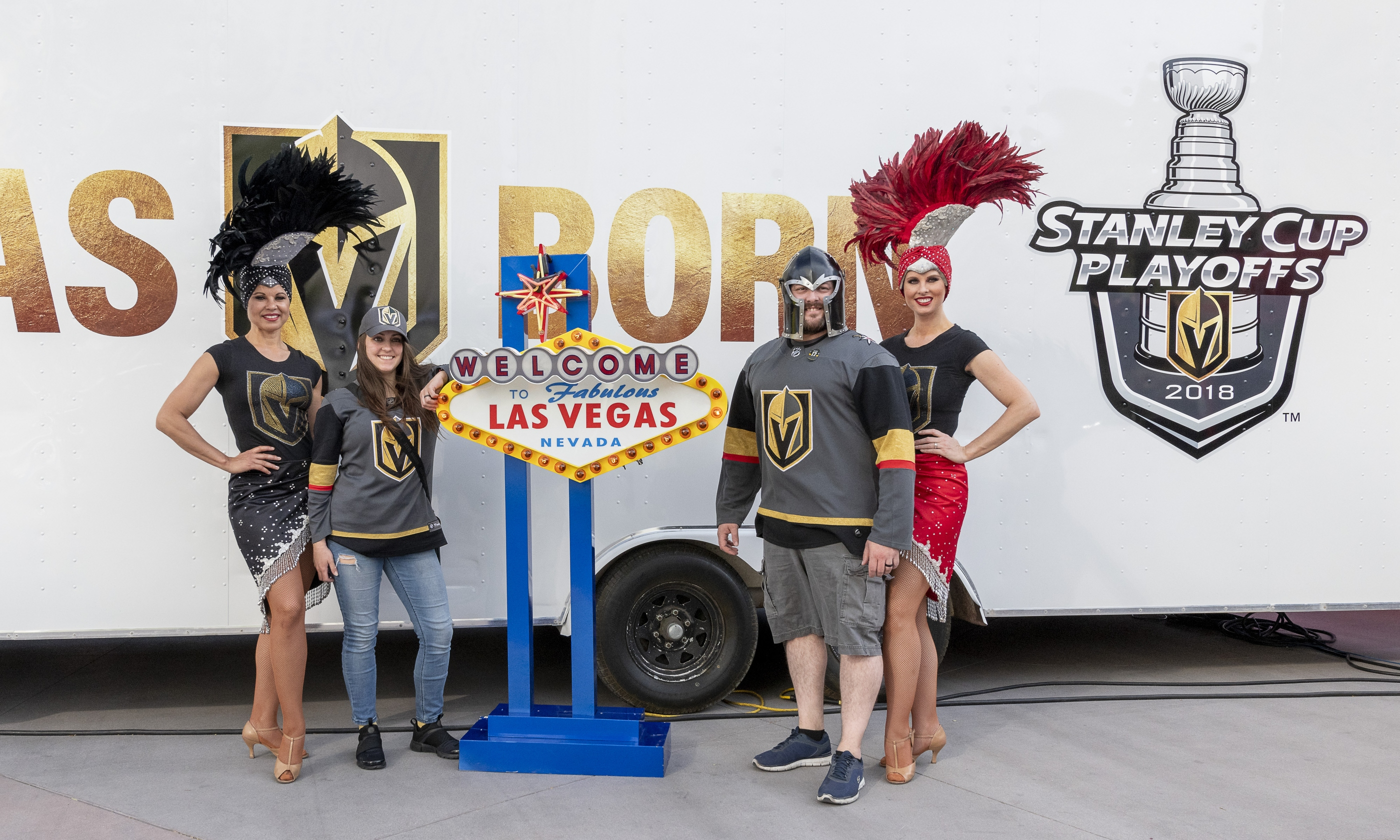 Showgirls pose for photos with fans as part of the pre-game celebration in Toshiba Plaza as the Vegas Golden Knights prepare to meet the Los Angeles Kings in the first quarterfinal game of the NHL Stanley Cup Playoffs at T-Mobile Arena in Las Vegas on Wednesday, April 11, 2018.  CREDIT: Mark Damon/Las Vegas News Bureau