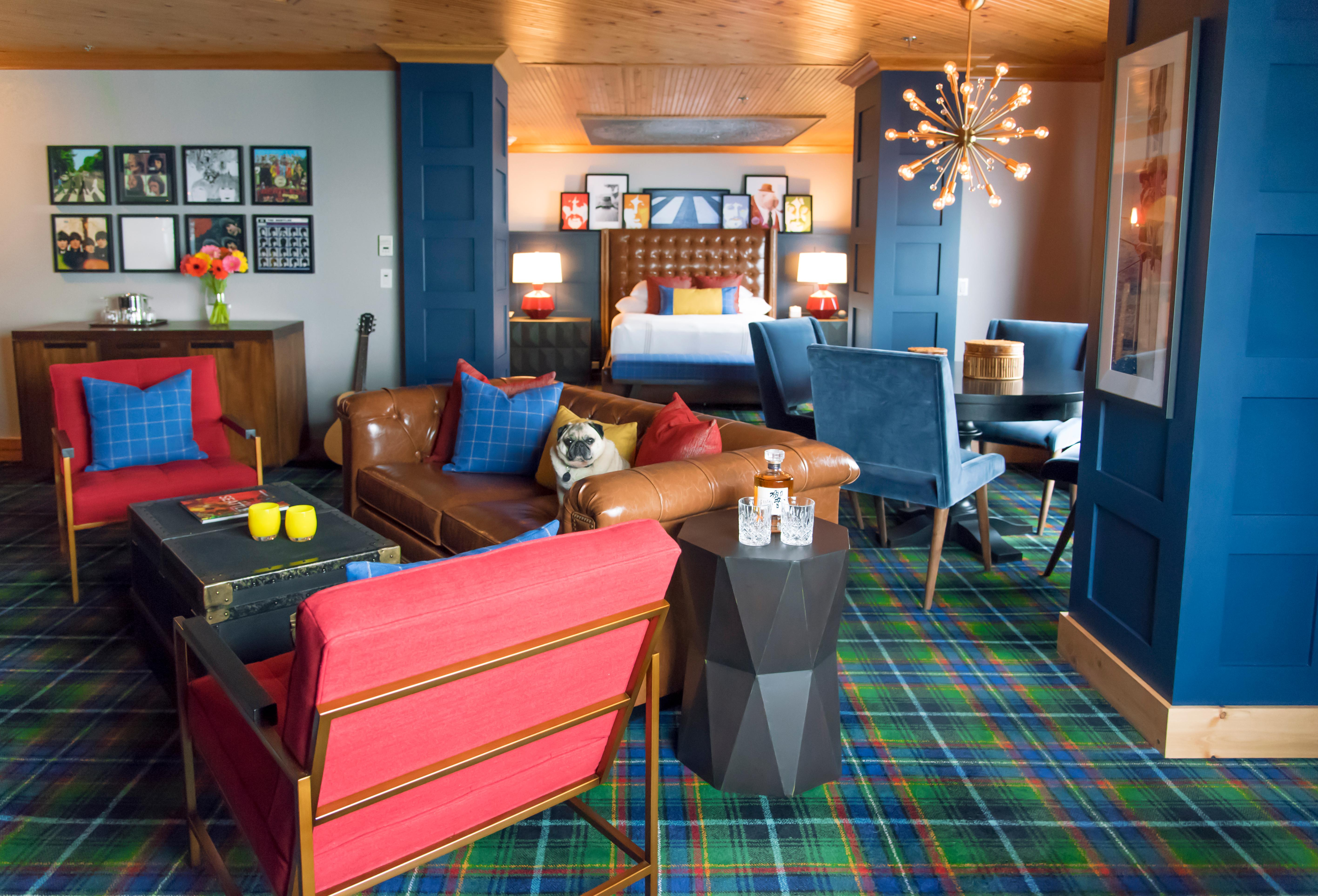 "The Beatles Suite. Guests can stay in the very same room The Beatles once stayed in, where the iconic ""fishing out the window"" photo was captured of the band fishing out the window, in The Edgewater's famous Beatles Suite. The suite includes fascinating portraits, memorabilia, Beatles history and music. With contemporary elements of dark metals, white glass, leather, and designer lighting, this is the ultimate entertainment suite for music lovers. The iconic Beatles Suite, which has long been a tribute to the hotel's famed guests, received a design refresh in 2018, complete with new Beatles memorabilia, turntables, records, and much more for the ultimate fan to indulge in. (Image courtesy of Edgewater Hotel)"