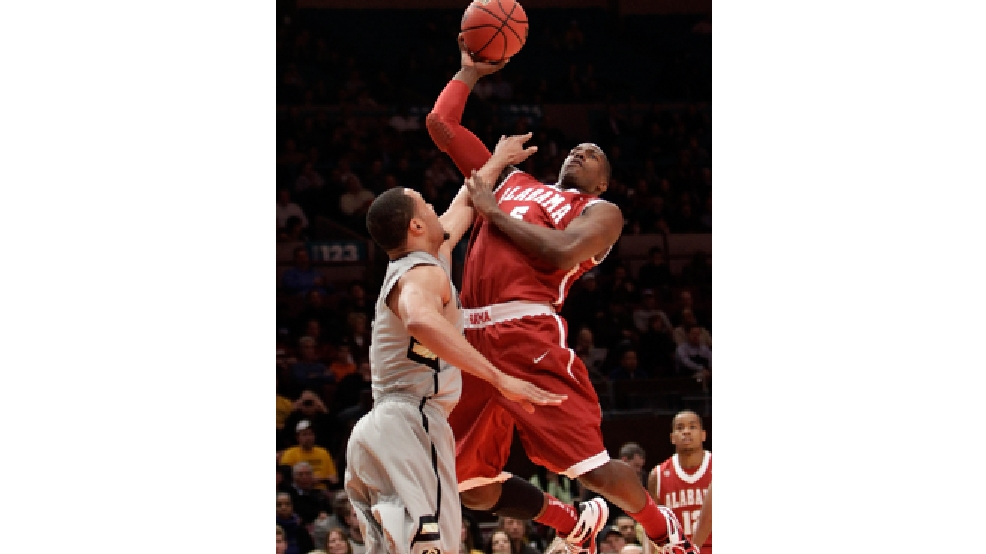 Alabama's Tony Mitchell (5) goes up against Colorado's Marcus Relphorde in the first half of a semifinal in the NIT college basketball tournament, Tuesday, March 29, 2011, at Madison Square Garden in New York. (AP Photo/Mary Altaffer)