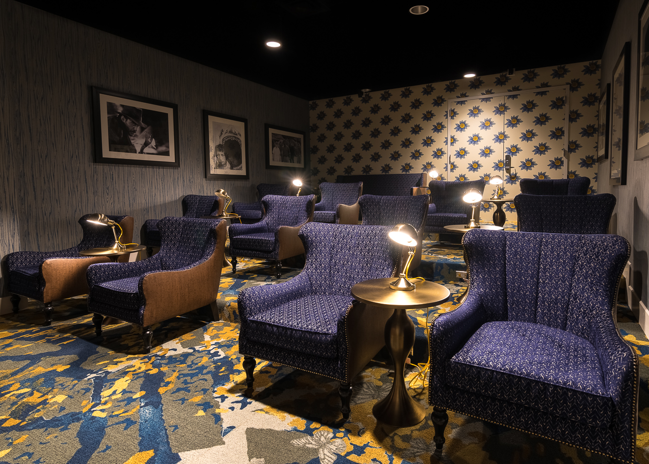 The theater room allows residents to retreat to a windowless room to watch movies on the big screen in comfortable chairs. / Image: Phil Armstrong, Cincinnati Refined // Published: 11.13.18
