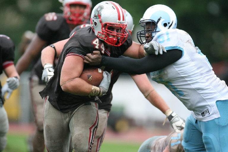 Develin was a defensive lineman at Brown, earning unanimous All-Ivy League first-team honors as a senior in 2009. He converted to fullback and played in the  defunct Arena and United leagues before catching on in the NFL. (Photo courtesy David Silverman)