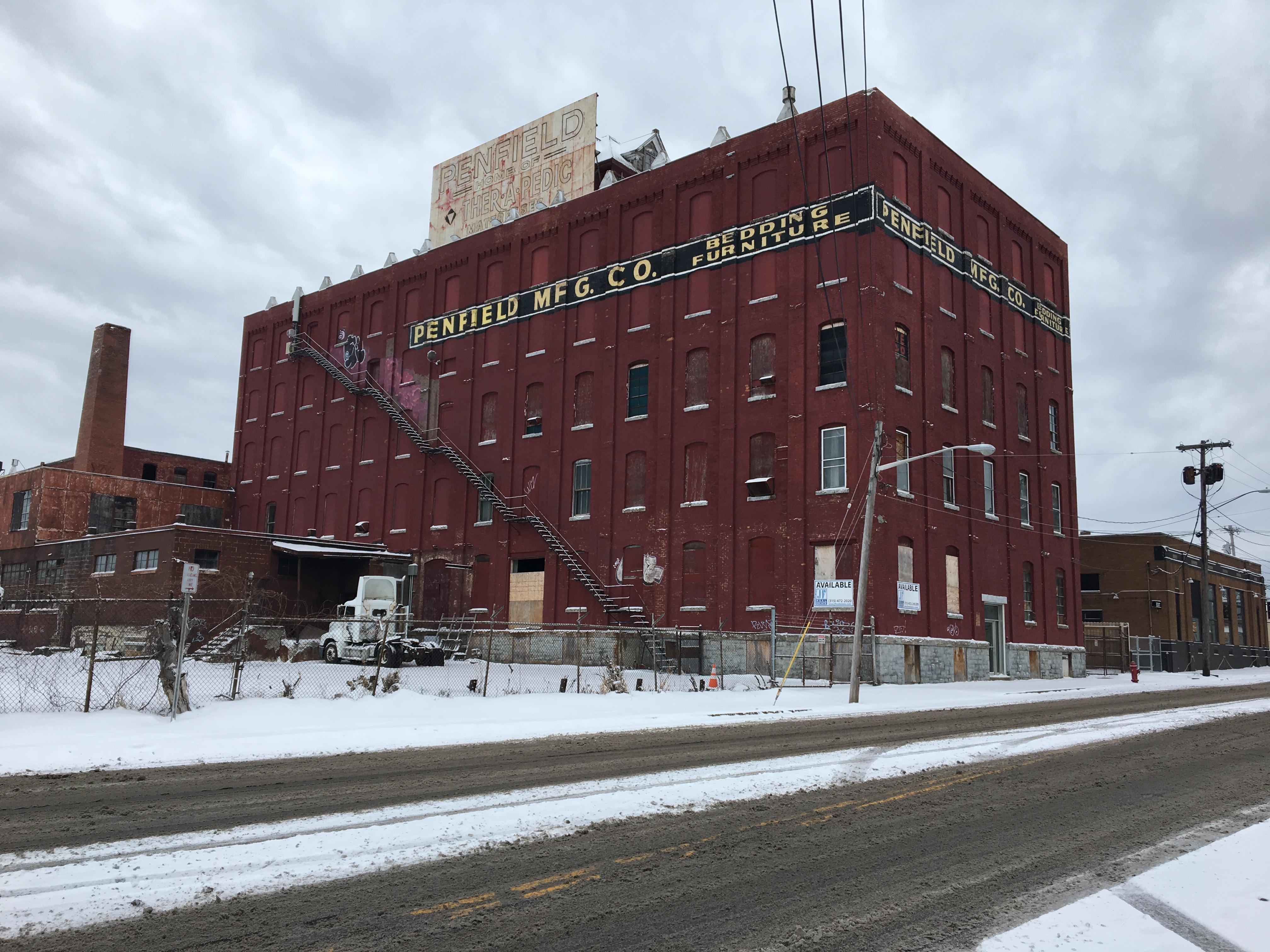 Syracuse's Penfield Manufacturing building has gained wide recognition for its unique Victorian style house on the roof. In reality, the structure was built simply to house the 5 story factories elevator motor. (Brett Hall/CNYCentral)<p></p>