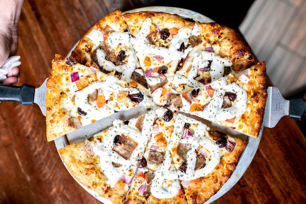 Chicago-Gyro Pizza: garlic butter base, fresh spinach, kalamata olives, tomatoes, red onion, gyro meat, mozzarella, provolone, and feta cheeses topped with tzatziki sauce / Image: Amy Elisabeth Spasoff // Published: 5.29.18