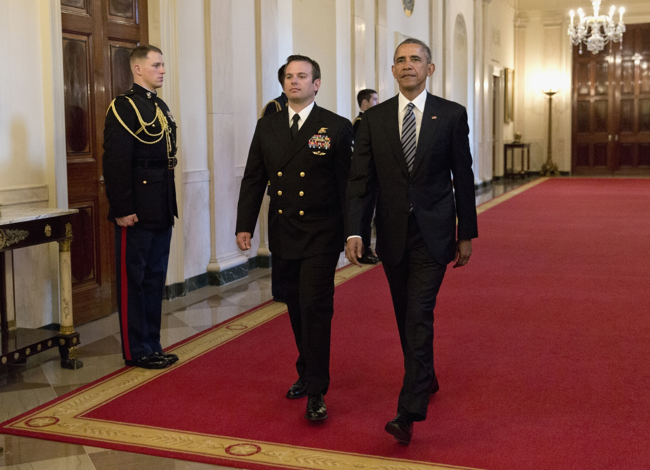 President Barack Obama and Senior Chief Special Warfare Operator Edward Byers arrive for a ceremony in the East Room of the White House in Washington, Monday, Feb. 29, 2016, where the president presented Byers with the Medal of Honor. U.S. Navy. Senior Chief Byers receives the Medal of Honor for his courageous actions while serving as part of a team that rescued an American civilian being held hostage in Afghanistan on December 8-9, 2012. (AP Photo/Carolyn Kaster)