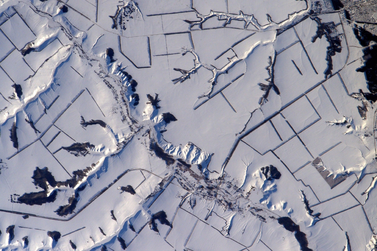 Snowy landscapes sometimes remind me of looking down a microscope for biology lessons at school or during @ESA_CAVES  (Photo & Caption: Thomas Pesquet // NASA)