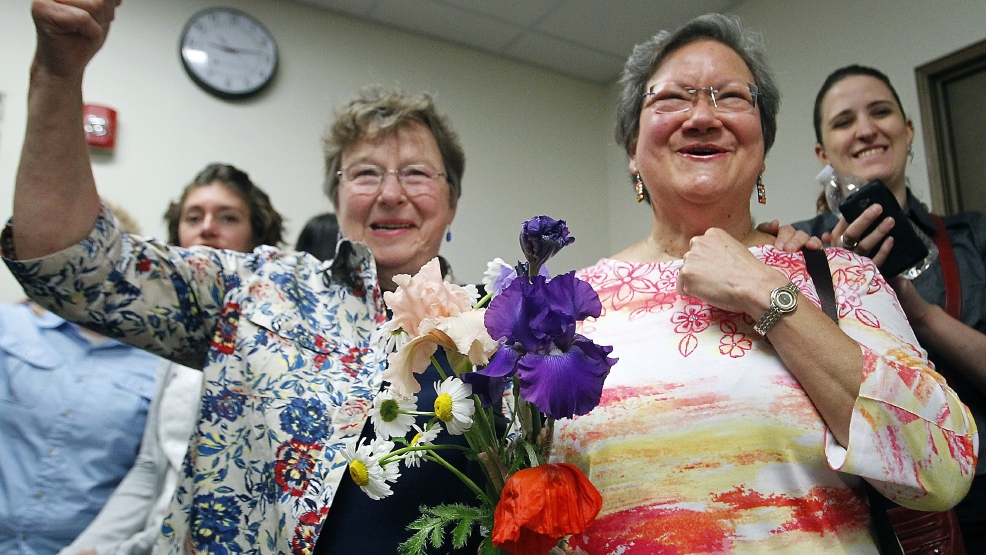 Miriam Douglass, left, and Ligia Rivera react Monday, June 9, 2014 to the announcement that marriage licenses would be granted, subject to a five day waiting period, in Outagamie County. The two were given the first same-sex marriage license in the county. (AP Photo/The Post-Crescent, Wm.Glasheen)