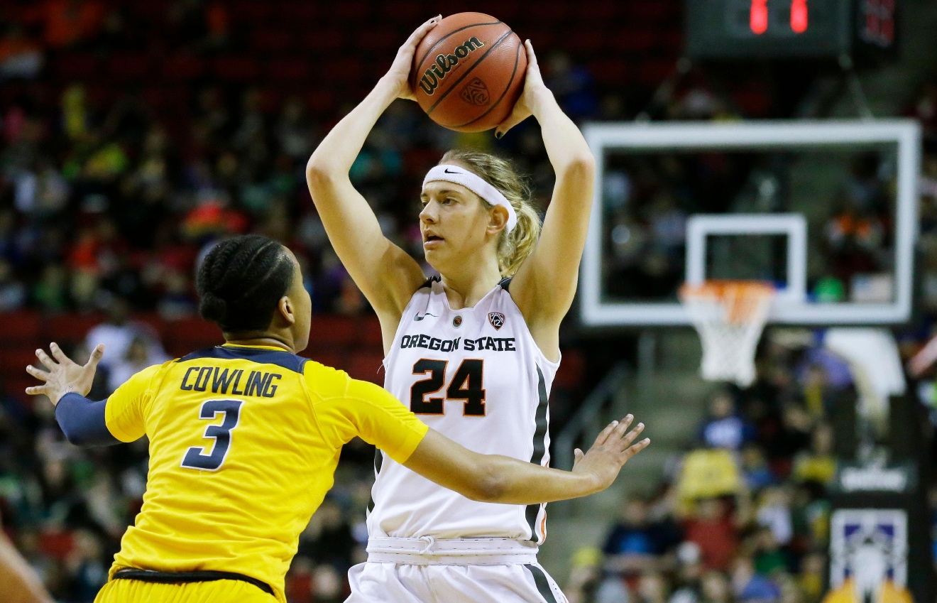 Oregon State guard Sydney Wiese (24) looks to pass around the defense of California forward Mikayla Cowling (3) in the first half of an NCAA college basketball game in the Pac-12 Conference tournament, Friday, March 3, 2017, in Seattle. (AP Photo/Ted S. Warren)