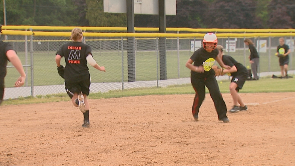 Mishicot softball players practice prior to the state tournament.