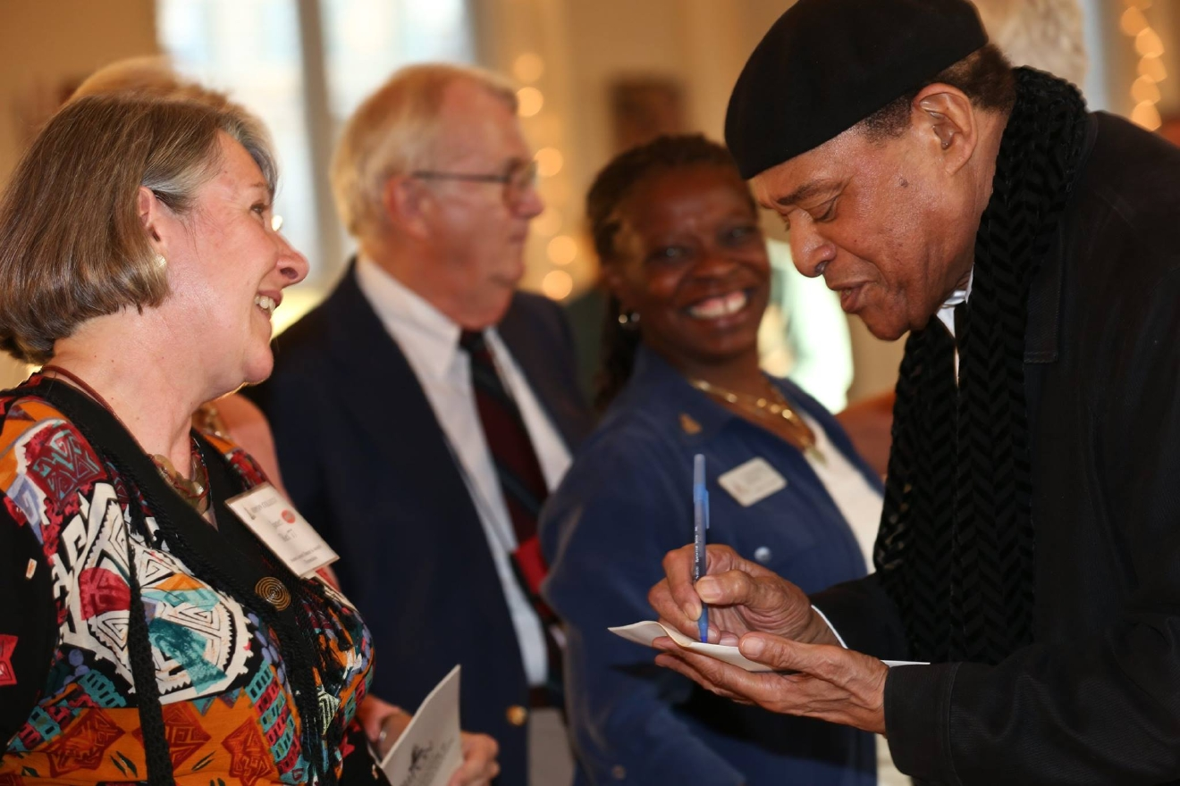 Al Jarreau signs autographs at Ripon College's Alumni Weekend in 2013. (Photo courtesy Ripon College)