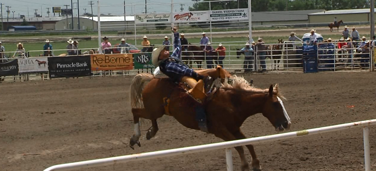 Kearney's Gauge McBride competes in the bareback riding event at the Nebraska High School Rodeo Finals. (NTV News)