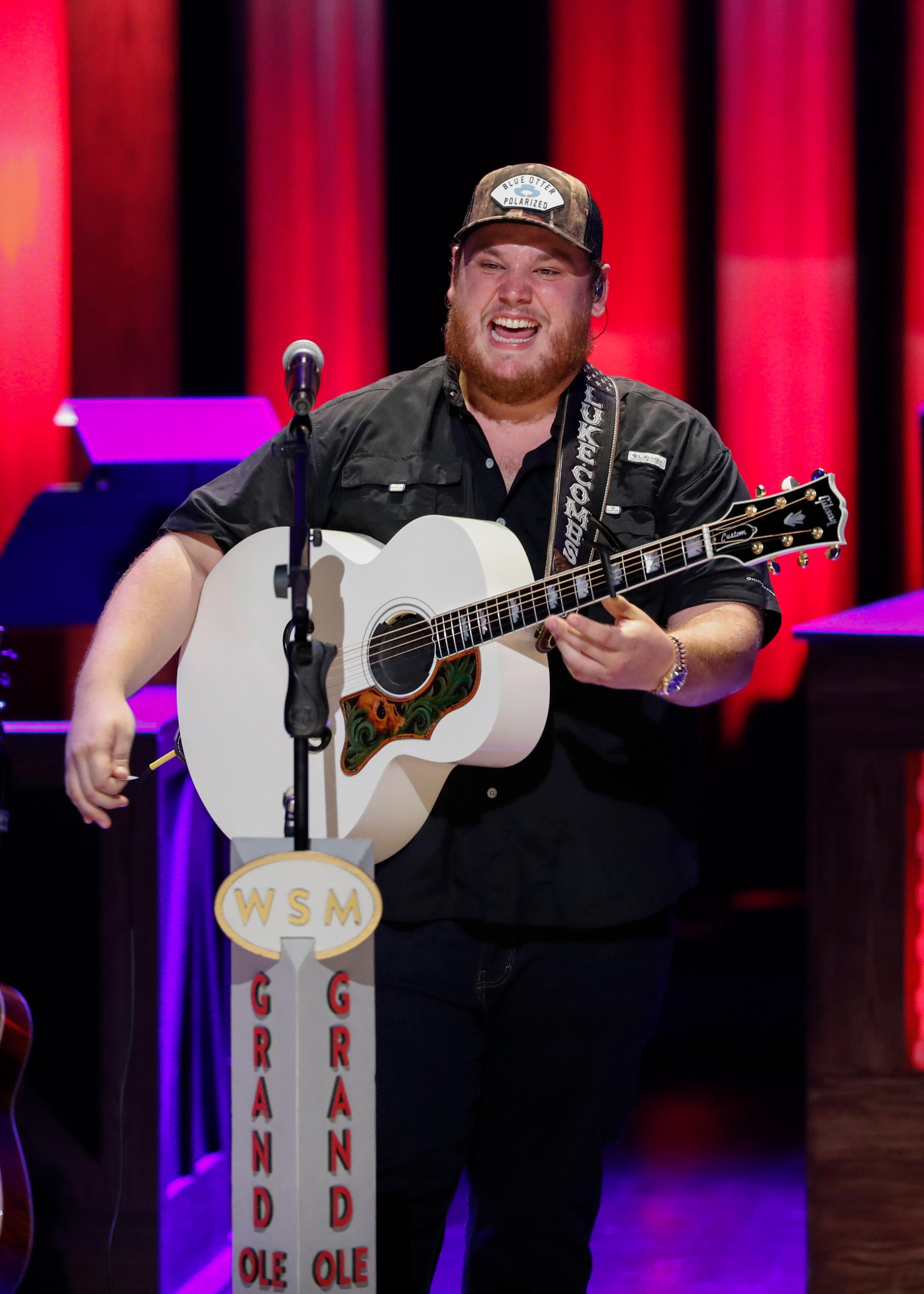 "Luke Combs performs at ""Luke Combs Joins the Grand Ole Opry Family,"" at Grand Ole Opry, Tuesday, July 16, 2019, in Nashville, Tenn. (Photo by Al Wagner/Invision/AP)"