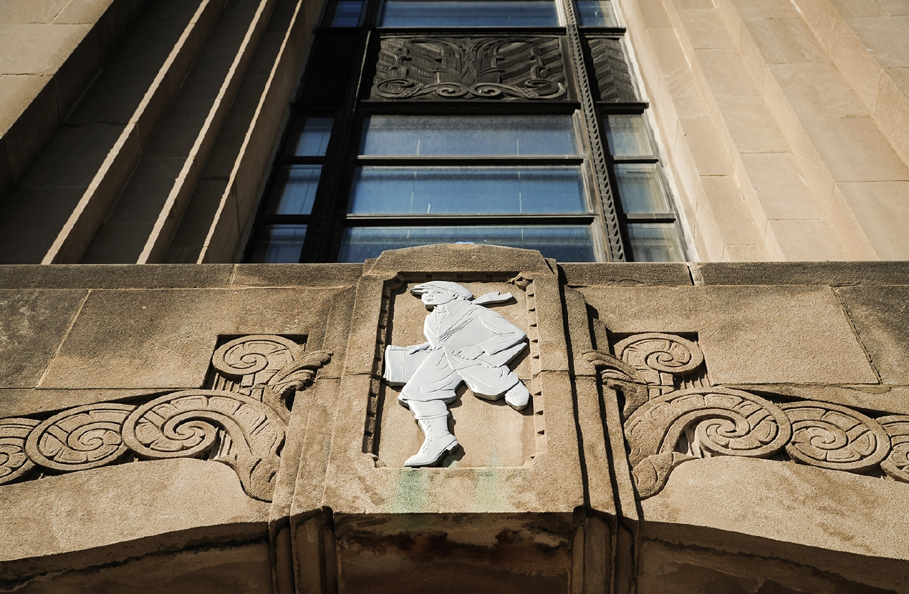 "BUILDING: Cincinnati Times-Star Building / LOCATION: 800 Broadway St (45202) -- Downtown / TIDBIT: A newsboy engraving pictured above the building's ""newsboys entrance."" The building once housed the Cincinnati Times-Star newspaper, and later the Cincinnati Post. / IMAGE: Melissa Doss Sliney"
