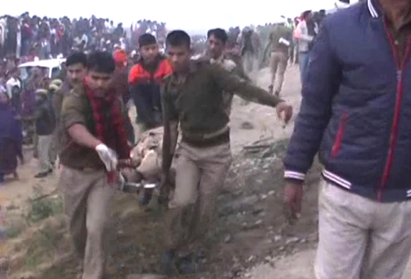 In this image made from video, India's security forces personnel work at the site of a train accident near Pukhrayan, about 270 kilometers (168 miles) from Allahabad, Sunday, Nov. 20, 2016. Rescue workers used gas cutters to pull out survivors after 14 coaches of a passenger train rolled off the track in northern India early Sunday, police said. (KK Productions via AP)