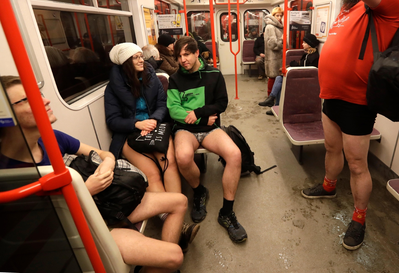 Passengers take part in the No Pants Subway Ride in Prague, Czech Republic, Sunday, Jan. 8, 2017. The No Pants Subway Ride began in 2002 in New York as a stunt and has taken place in cities around the world since then. (AP Photo/Petr David Josek)