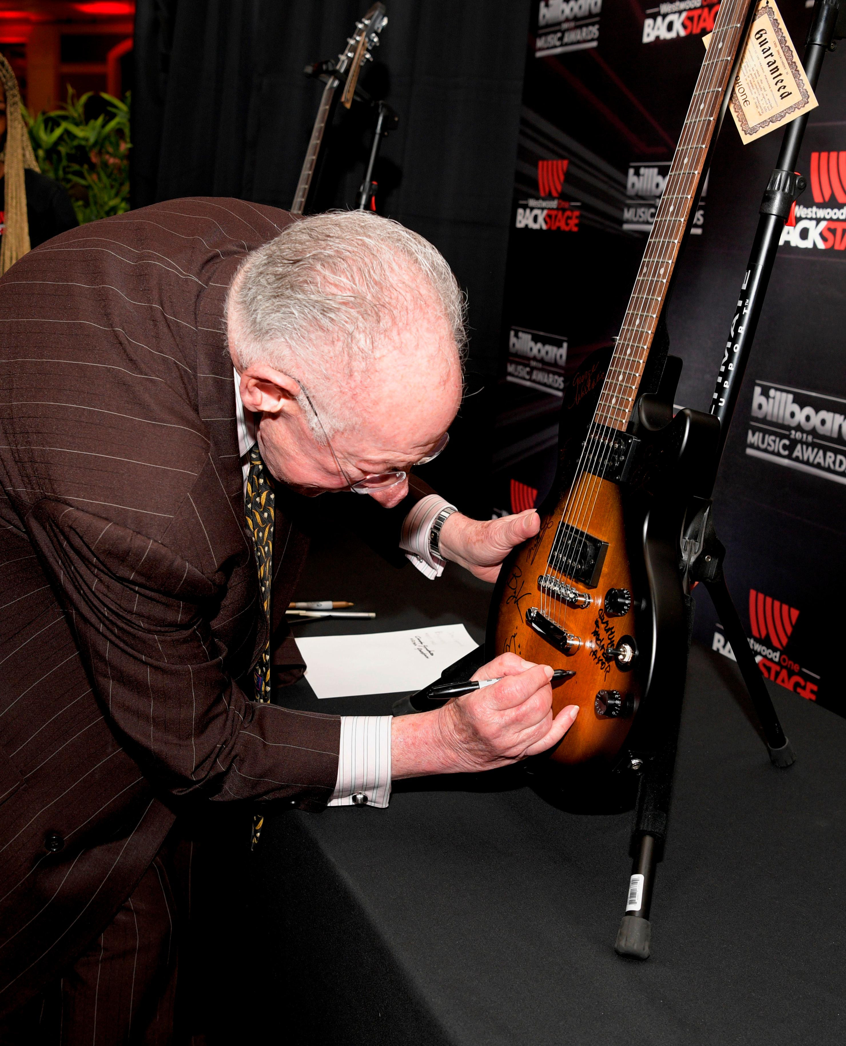 Former Las Vegas Mayor Oscar B. Goodman autographs guitars at the Billboard Music Awards Radio Row with representatives from across the country at the MGM Grand Hotel & Casino on the Las Vegas Strip. Saturday, May 19, 2018. CREDIT: Glenn Pinkerton/Las Vegas News Bureau