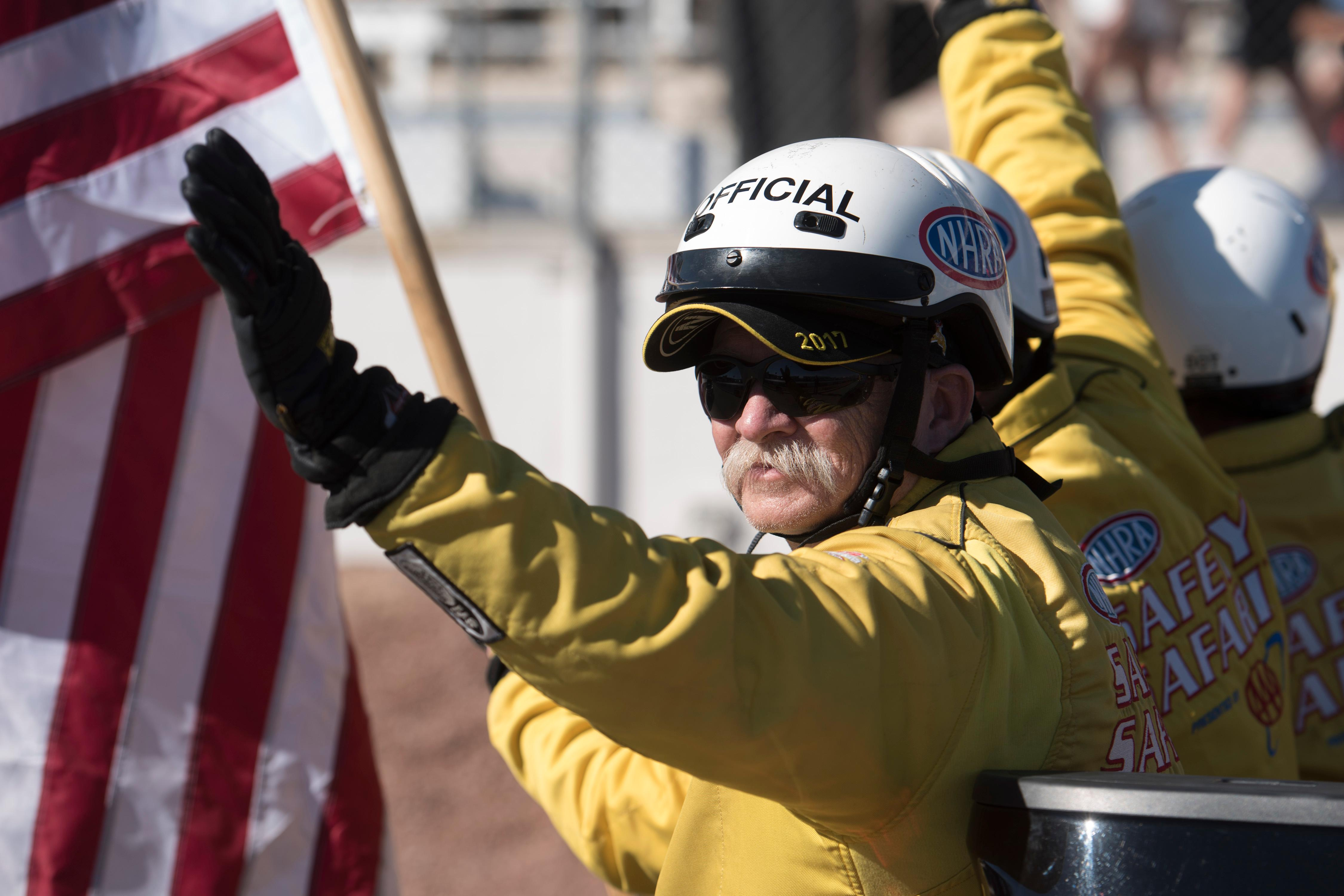 A safety official waves to the crowd at the NHRA Toyota Nationals Sunday, October 29, 2017, at The Strip at the Las Vegas Motor Speedway. CREDIT: Sam Morris/Las Vegas News Bureau