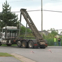 Truck snags wires, briefly shuts down traffic in Henrietta